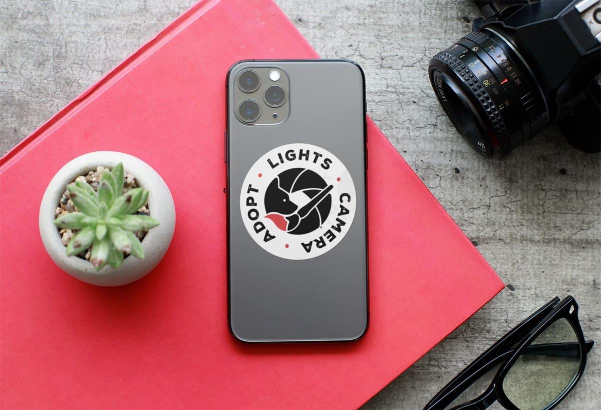 LightsCameraAdoptCellPhone - Sticker - Lights. Camera. Adopt.
